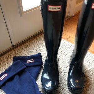 Blue tall Hunter rain boots with socks